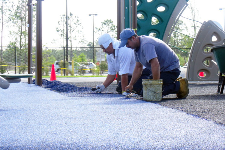 rubber playground surfacing installation